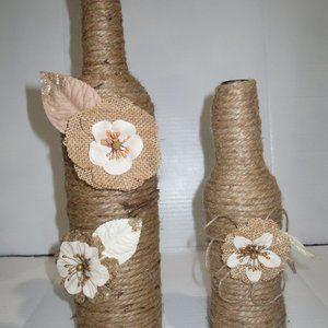 2 Jute wrapped wine bottles/cases. Burlap flowers.